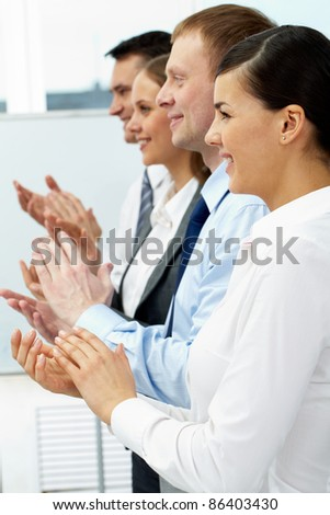 Row of clapping business people - stock photo