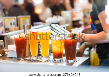 Row of cocktails for brunch at the bar. - stock photo