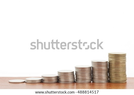 Row of coins on wood table