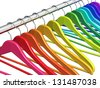 Row of color rainbow coat hangers on metal shiny clothes rail isolated on white background - stock vector