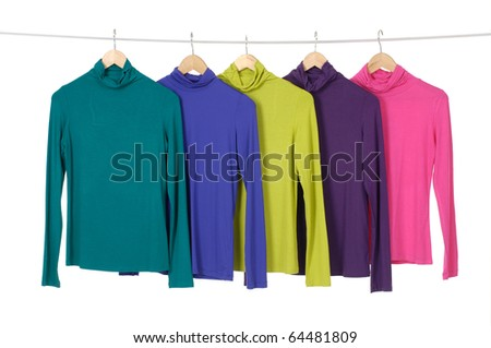Row of colorful clothing on hanger rack display
