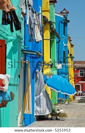 Row of colorful houses on the island of Burano, off of Venice.