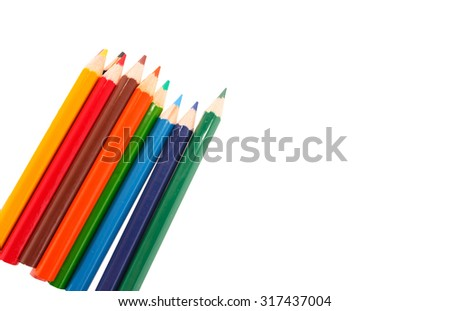 row of colorful pencils on white background