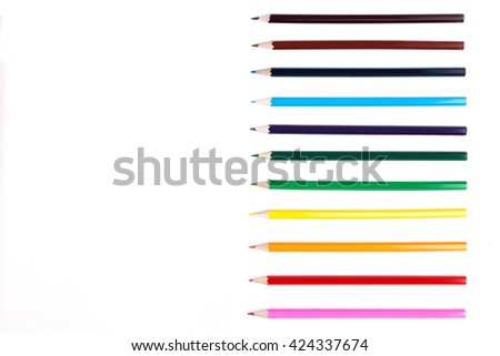 Row of colorful pencils on white surface. Mock up - stock photo
