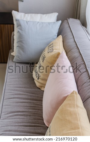 row of colorful pillows on sofa at home