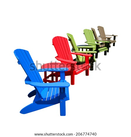 Row of colorful recycled plastic resin color Adirondack chairs and tables made of HDPE recycling lumber for outdoor patio furniture decor isolated on white  - stock photo