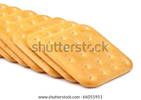 Row of crackers isolated on a white background - stock photo