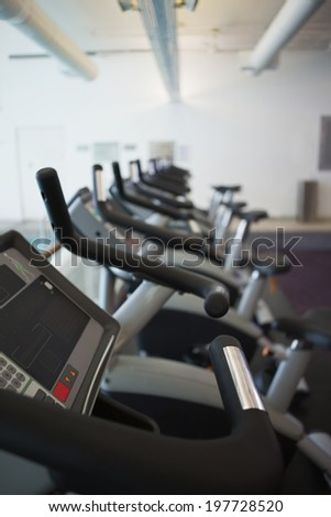 Row of cross trainer machines at the leisure center
