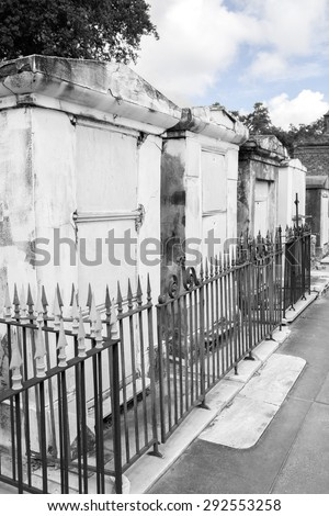 Row of crumbling brick tombs in New Orleans with black & white filter effect - stock photo