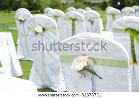 Row of decorated chairs on a outdoor wedding - stock photo