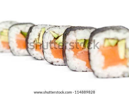 Row of delicious maki sushi rolls, isolated on white. Japanese food - stock photo