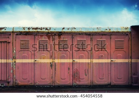 Row of dirty and rusty lockers standing outside. Grunge style. - stock photo