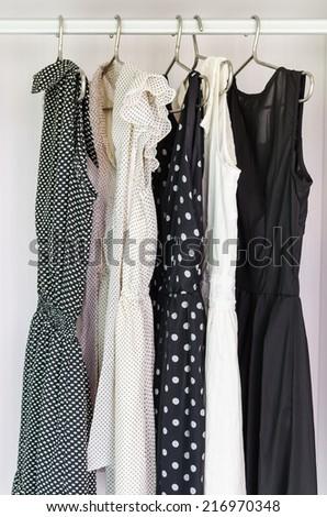 row of dress hanging on coat hanger - stock photo