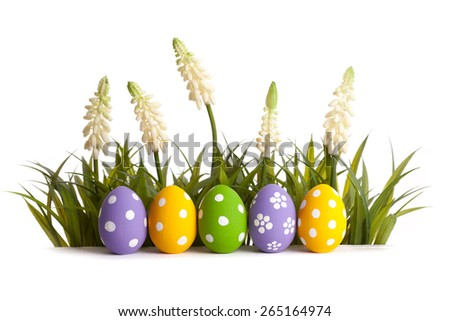 Row of Easter eggs in Fresh Green Grass. Studio shot - stock photo