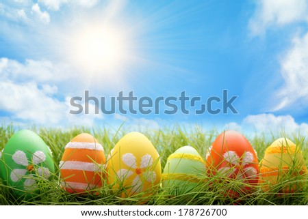 Row of Easter eggs on meadow