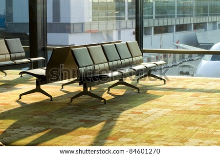 Row of empty chairs at Changi airport, Singapore.
