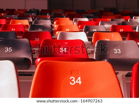 row of empty stadium seats colored
