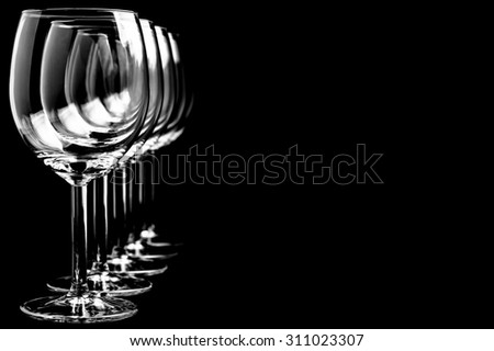 Row of empty wine glasses  on a black background in horizontal format