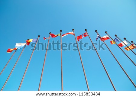 Row of european flags against blue sky background
