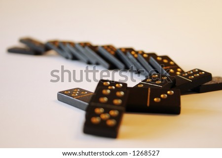 Row of fallen dominoes - stock photo