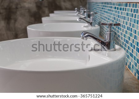 Row of Faucet with water drop on the front - stock photo