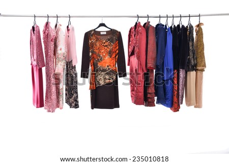 row of female clothing on hanging  - stock photo