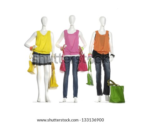 Row of female three mannequins in bag on three background - stock photo