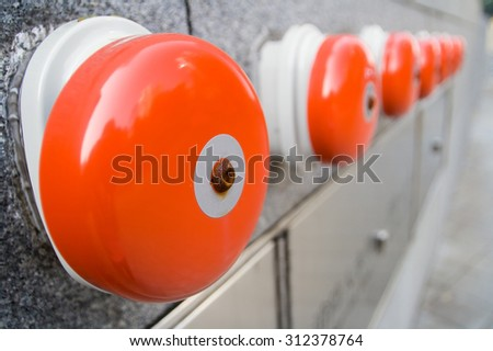 Row of fire alarm outside a building - stock photo
