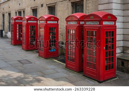 Row of five traditional red K2 type telephone kiosks in central London, UK near Covent Garden.