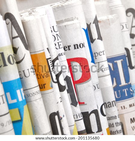 Row of folded newspapers - stock photo