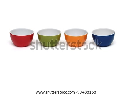 Row of four porcelain bowls isolated on white background - stock photo
