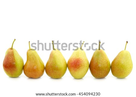 "row of fresh ""Forelle"" pears on a white background - stock photo"