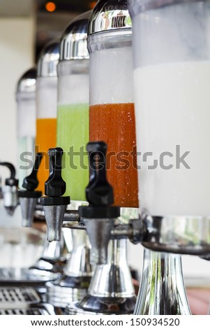 Row of fresh juice at buffet hotel restaurant - stock photo