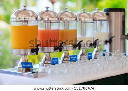 Row of fresh juice at buffet restaurant - stock photo