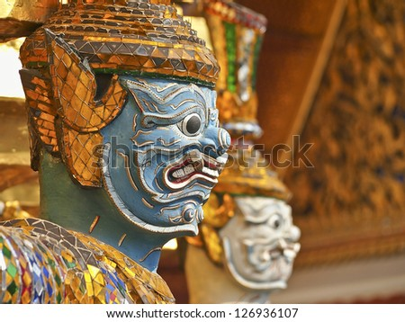 row of gian's face in grand palace