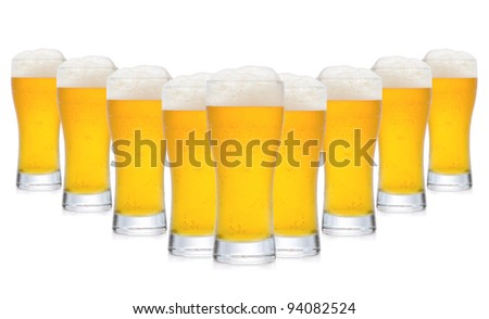 row of glasses of beer on white background