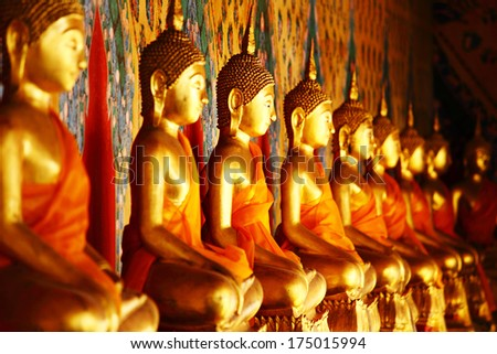 Row of golden buddha statue - stock photo