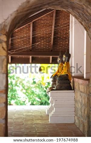 Row of golden buddha statue  - stock photo