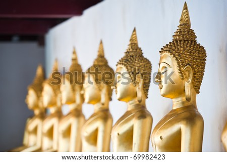 Row of Golden Buddha Statue at Temple