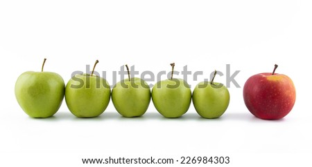 row of green apples and one red