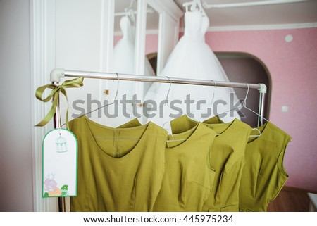 Row of green bridesmaid's dresses in the morning