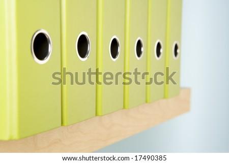 Row Of Green Ring Binders - stock photo