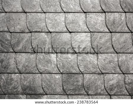 row of grey roof slate in harmonic pattern - stock photo