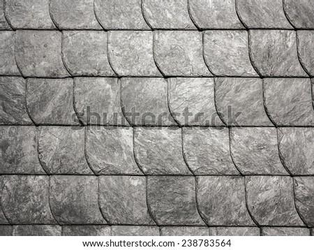 row of grey roof slate in harmonic pattern - stock photo