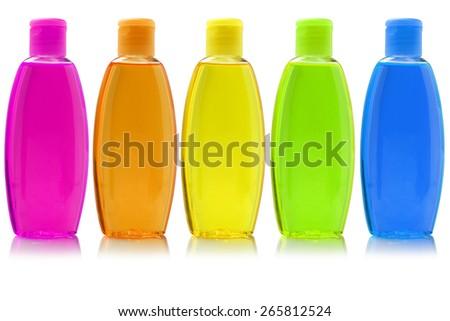 Row Of Hair Shampoo On White Background - stock photo