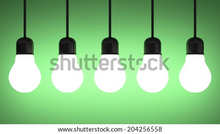 Row of hanging glowing tungsten light bulbs on green textured background - stock photo