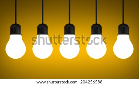 Row of hanging glowing tungsten light bulbs on yellow textured background - stock photo