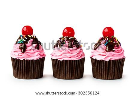 Row of ice cream sundae cupcakes on white - stock photo