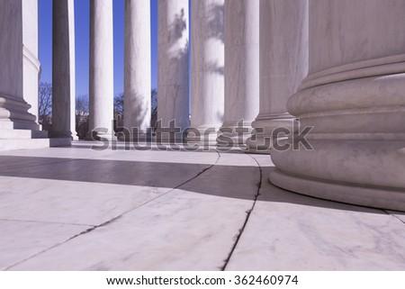 Row of Ionic Columns around Thomas Jefferson memorial building.  - stock photo