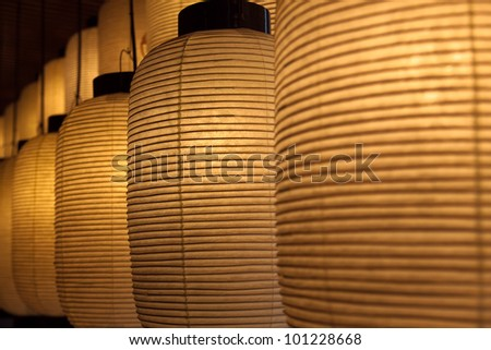 Row of Japanese lanterns with shallow depth of field - stock photo